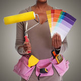Woman hands with painting roller. Stock Image