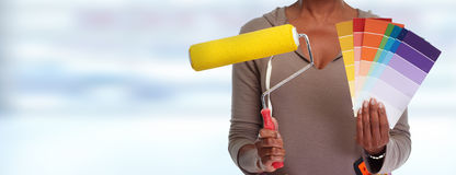 Woman hands with painting roller. Stock Photos