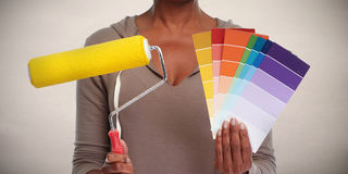 Woman hands with painting roller. Royalty Free Stock Photos