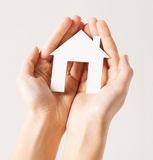 Woman hands with paper house Stock Photo