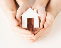 Woman and hands with paper house Stock Photography