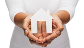 Woman hands with paper house Stock Photos