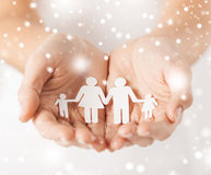 Woman hands with paper man family Royalty Free Stock Photography
