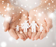 Woman hands with paper man family Royalty Free Stock Images
