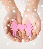 Woman hands with paper women. Love, romance, human rights, lesbian, family concept - woman hands showing two paper woman with heart shape Stock Photo