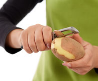 Woman hands peeling potato Royalty Free Stock Photos
