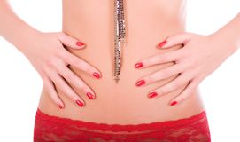 Woman hands with perfect red manicure on her belly Stock Image