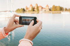 Woman hands with phone taking picture of historical place Royalty Free Stock Photos