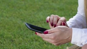 Woman hands with phone touching screen stock footage