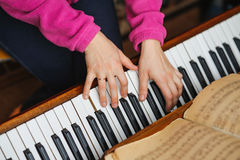 Woman hands on a piano key Stock Photos