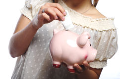 Woman hands and piggybank Stock Image