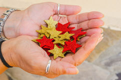 Woman hands with pile of decorative stars Royalty Free Stock Photo