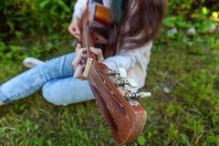 Woman hands playing acoustic guitar royalty free stock photography