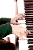 Woman hands playing at the piano Stock Photography