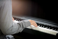 Woman hands playing piano Stock Images