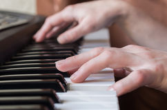 Woman hands playing piano music. Stock Photography