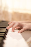Woman  hands playing piano Stock Photos