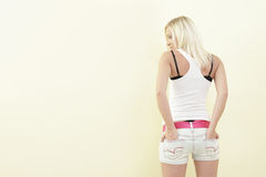 Woman with hands in pockets Royalty Free Stock Photos