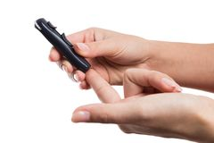 Woman hands poking finger to check glucose or blood sugar level royalty free stock photos