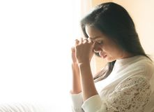 Woman hands praying to god. Near the window stock images