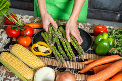 Woman Hands Preparing Raw Veggies. On a Wooden Table Stock Photography