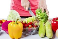 Woman Hands Preparing Vegetable Salad Stock Images