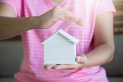 Woman hands presenting a house. Real estate agent offer house. P Royalty Free Stock Images
