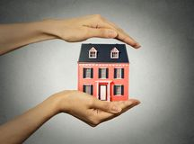 Woman hands presenting small model of house Stock Photography