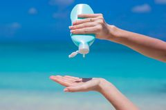 Woman hands putting sunscreen from a suncream Stock Images