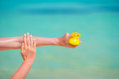 Woman hands putting sunscreen from a suncream Royalty Free Stock Photography
