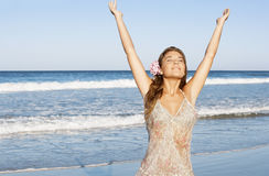 Woman With Hands Raised Standing Against Sea Royalty Free Stock Photos