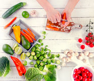 Woman hands with raw carrot.  Healthy food concept. Flat lay Royalty Free Stock Images