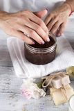 Woman hands receiving a hand scrub peeling Stock Images