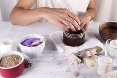 Woman hands receiving a hand scrub peeling Royalty Free Stock Image