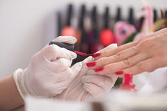 Woman hands receiving a manicure Royalty Free Stock Images