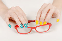 Woman hands with red glasses Stock Photography