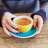 Woman hands with red manicure and cup of coffee Royalty Free Stock Images