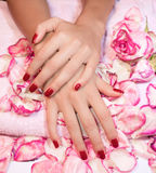 Woman hands with red manicure Stock Images