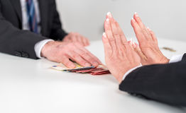 Woman hands rejecting an offer of money Stock Image