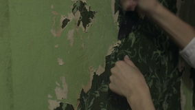 Woman hands removing wallpaper stock footage