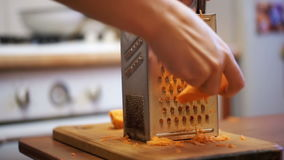Woman Hands Rubbing Carrots on Grater in a Home Kitchen. Slow Motion stock video