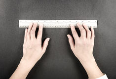Woman hands with ruler Stock Photo