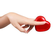 Woman hands with scissors and heart isolated Royalty Free Stock Image
