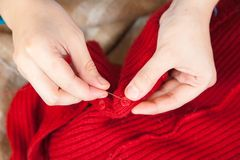 Woman hands sewing a button