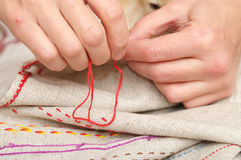 Woman hands sewing with muline Stock Photos