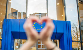 Woman hands in shape of love Europe Union Stars. Woman hands in shape of love heart with the stars of European Union in the lhearts shape Stock Photos