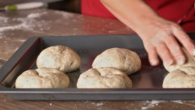 Woman hands shaping the dough making buns stock footage