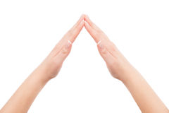 Woman hands showing home symbol gesture Royalty Free Stock Images