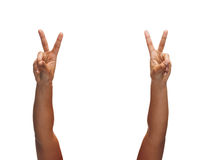 Woman hands showing v-sign Stock Photo