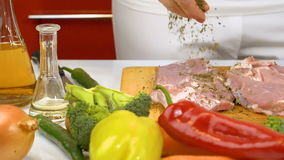 Spicing fresh raw meat in slow motion stock footage